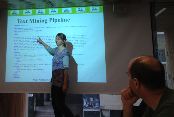 Bea Alex shares text mining progress with the team at an early Trading Consequences meeting.